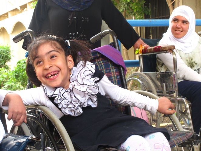 Noor, in a happy moment, at the school for disabled kids she attends in Baghdad. March, 2013