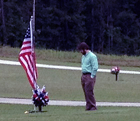 John Alderman, who was captain of Mike's cavalry troop in Iraq, at the grave Thursday.