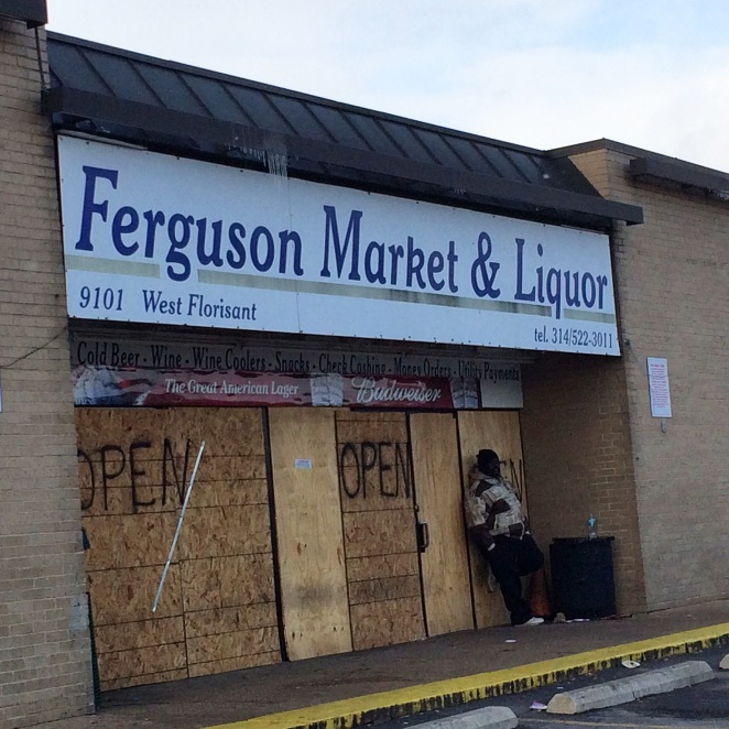 Many businesses on West Florissant Avenue are boarded up ahead of the grand jury decision.