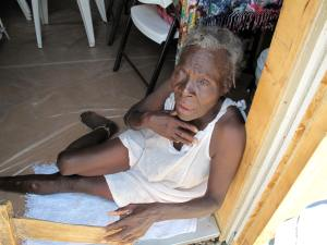 This old woman was displaced from her home in Leogane got lucky to find temporary housing built by Habitat for Humanity. May 2010