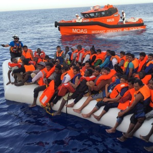 The team from MOAS gets ready to  rescue migrants who set sail from Libya on a rubber dinghy.