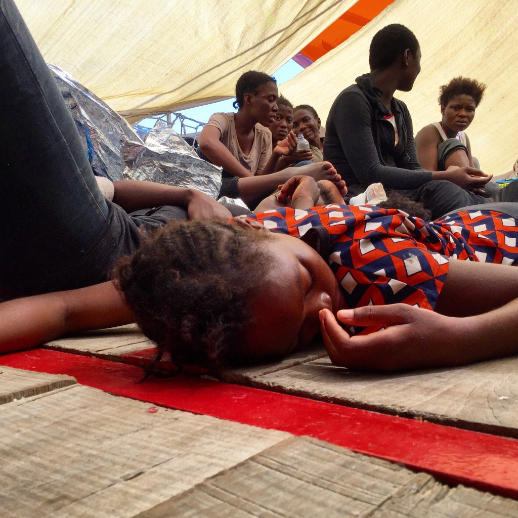 Eva, a Nigerian woman, gets some much needed sleep after being rescued at sea.